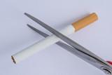 no smoking, scissors cut a cigarette