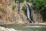 Bay, steep cliff and a waterfall at the Waterfall Bay Park in Hong Kong, China.