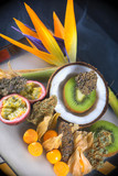 Assorted dried cannabis buds with fresh tropical fruit - medical