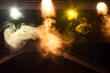 Colorful lights with smoke in club, concert.