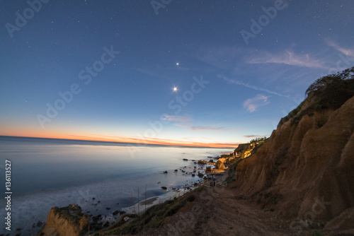 The Moon and Venus in the evening sky over El Matador Beach after sunset Poster