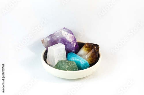 Tuinposter Edelsteen Variety collection of healing crystals and minerals in a bowl over white background