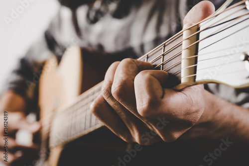 Póster Close up of man hand playing guitar.