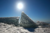 On lake Baikal in winter. Ice block on the ice field of the lake in the sun at the Zenith.