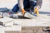 Laying of paving slabs - 136140903