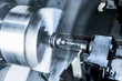 The rotating lathe spindle.
