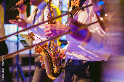musician plays the saxophone performance at a concert - 136146969