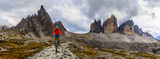 View of cyclist riding mountain bike on trail in Dolomites,