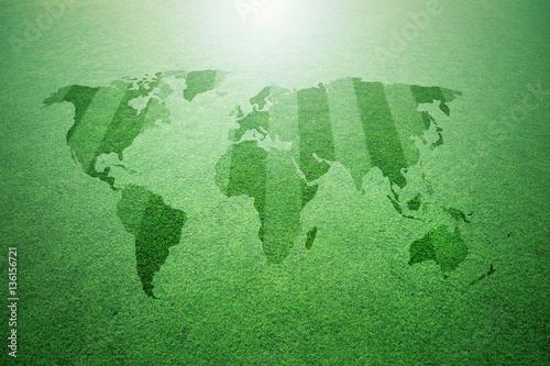 Fotobehang Wereldkaarten Conceptual sunny green soccer grass field pattern with world map background.