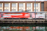 Smearing photo of a red streetcar in Milan