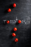 Tomatoes over dark background