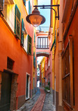 Picturesque colorful narrow curve small street with streetlight in Manarola fishing village in Five lands, Cinque Terre National Park, Liguria, Italy.