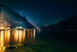 Scenic night view of illuminated town Limone sul Garda, Italy