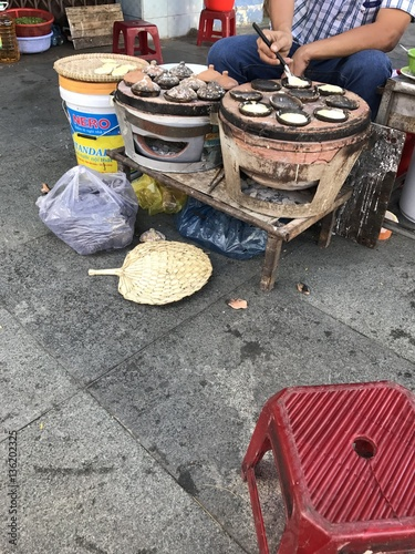 Asian, Vietnam street food , banh can, hot cooked quail eggs