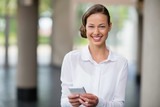 Portrait of businesswoman holding mobile phone
