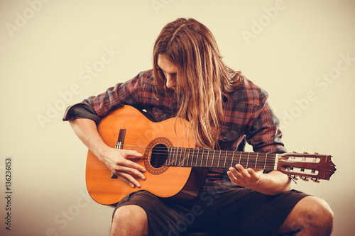Poster Guitarist is playing the guitar.