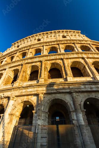 Colosseum or Coliseum Amphitheatre, evening in Rome.