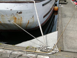Detail, fishing boat tied up to dock