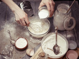 Graceful female hands prepare dough for cupcakes. Home-made pastries. Soft vintage toning