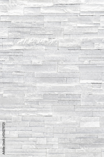 Fotobehang Stenen White stone veneer wall texture. Stone veneer tiles stacked flat make beautiful & modern accent walls in interior design. Use this gray texture as wallpaper, background, backdrop and more!