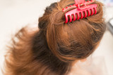 Woman head and red Hairpin on hair.