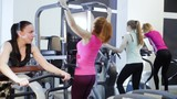 attractive woman works out on leg press machine at the gym