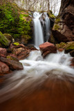 Waterfall / Springtime view of a waterfall among red rocks in Balkan Mountains, Bulgaria
