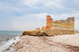 Old greek ruin on the sea coastline as global flood concept. Noahs Flood concept. Earth under water - Great Worldwide Flood