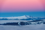 Incredible views of the mountain range winter sunset