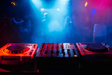 remote and mixer DJ for music in the night club