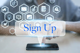 Woman using smart phone pressing button sign up icon. business login application technology concept.