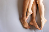 Legs of interracial couple in bed - copy space  - 136324566