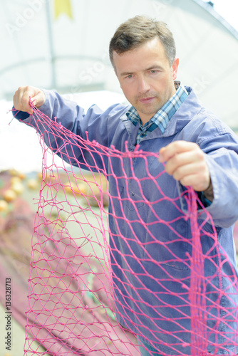 fisherman checking the net Poster