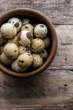 quail eggs on rustic wooden table