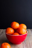 mandarins on red plate