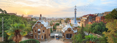 Papiers peints Barcelone Park Guell in Barcelona. View to entrace houses with mosaics on foreground
