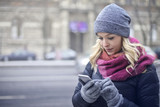 Blonde typing on the phone
