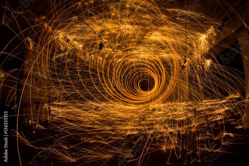 Fotobehang Oude verlaten gebouwen Freezelight using spinning burning steel wool and pyrotechnics