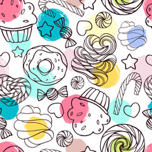 Seamless pattern with candy, donuts and lollipops.