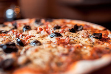 pizza with olives and cheese