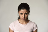 latin angry and upset woman looking furious and crazy moody in intense anger emotion