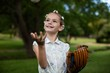 Cute girl with baseball in park