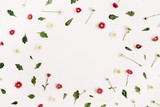Frame wreath with red and white wildflowers, green leaves, branches on white background. Flat lay, top view. Flower background. - 136398144