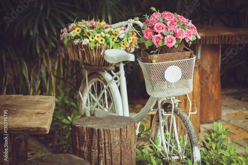 Plexiglas Fiets flower with bicycle decoration vintage color tone.