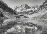 Black and white picture of Maroon Bells reflected in lake, Aspen in Colorado, USA.