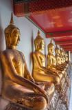 alignement de bouddhas dorés, temple de Wat Pho, Bangkok, Thaïlande