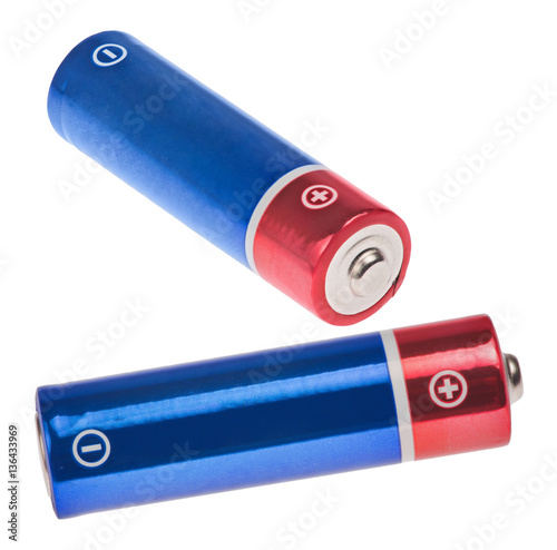 two red and blue batteries on white Poster
