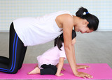 Mother and daughter doing exercise or Yoga