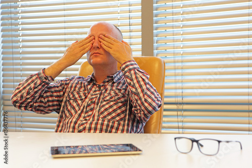 middle age  practicing yoga for eyes in office - break Poster
