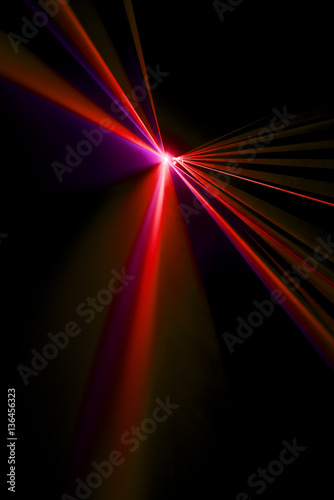 Laser beam red on a black background - 136456323